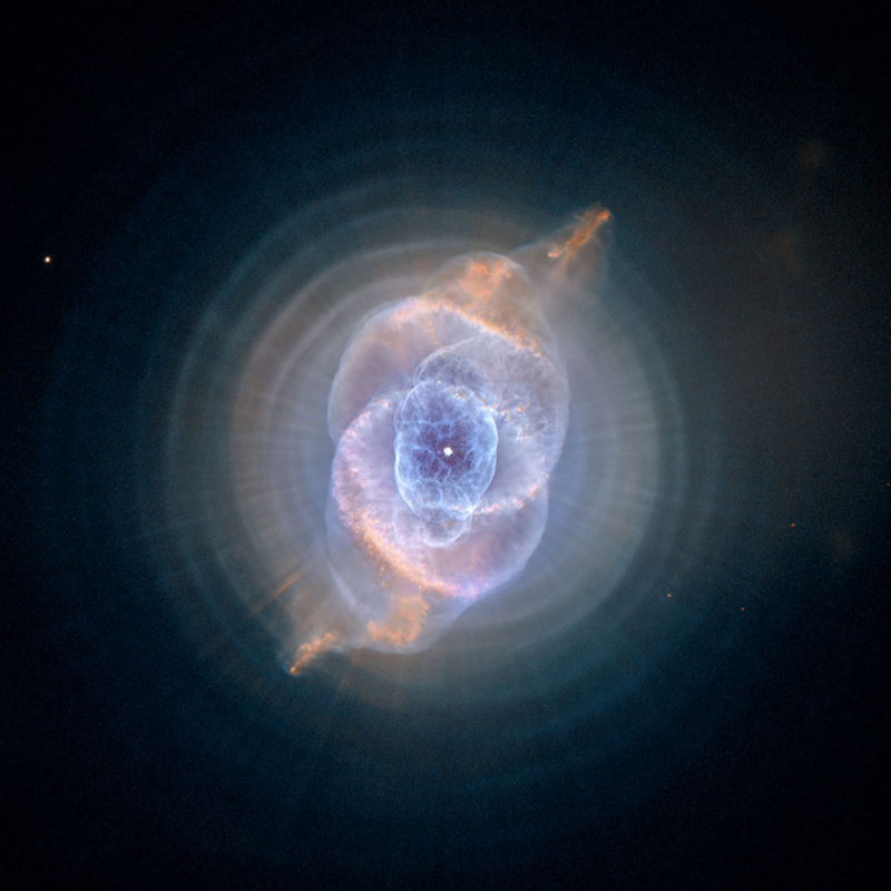 "In this detailed view from the NASA/ESA Hubble Space Telescope, the so-called Cat's Eye Nebula looks like the penetrating eye of the disembodied sorcerer Sauron from the film adaptation of ""Lord of the Rings."" The nebula, formally catalogued NGC 6543, is every bit as inscrutable as the J.R.R. Tolkien phantom character. Although the Cat's Eye Nebula was among the first planetary nebula ever to be discovered, it is one of the most complex planetary nebulae ever seen in space. A planetary nebula forms when Sun-like stars gently eject their outer gaseous layers to form bright nebulae with amazing twisted shapes."